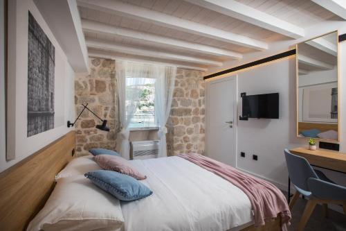 Letto o letti in una camera di Bova Luxury Rooms