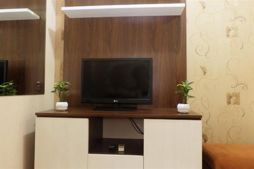 A television and/or entertainment center at Best Location 2BR Menteng Square By Travelio