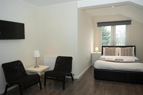 A bed or beds in a room at Guest House London