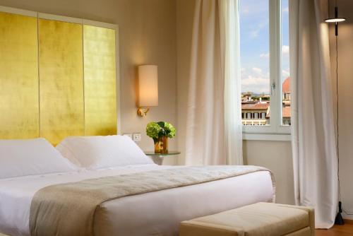 Letto o letti in una camera di Grand Hotel Minerva