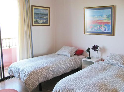 A bed or beds in a room at Chalet Anagato