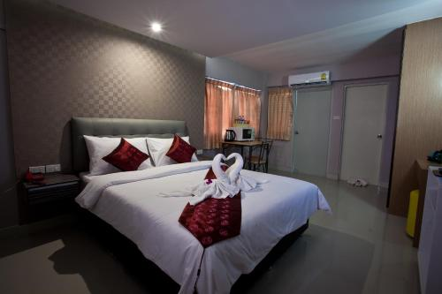A bed or beds in a room at NRC Residence
