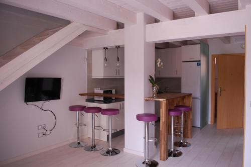 Una cocina o zona de cocina en Apartamentos La Harinera
