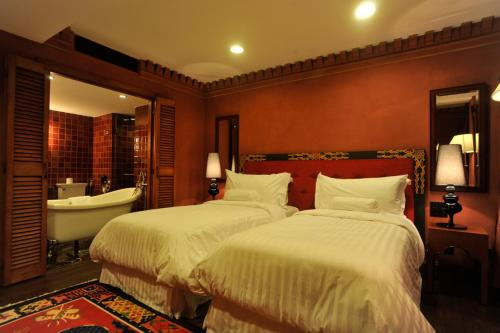 A bed or beds in a room at Hotel Druk