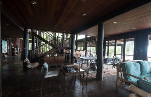 A restaurant or other place to eat at The Barn Daintree Holiday House