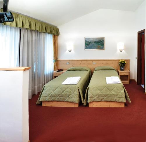 A bed or beds in a room at La Rotonda