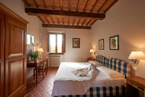 A bed or beds in a room at Borgo Il Melone