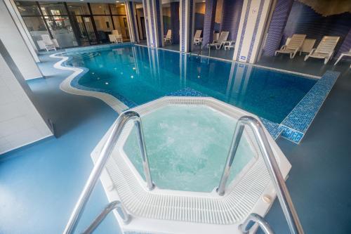 The swimming pool at or near Rhodopi Home Hotel - Half Board