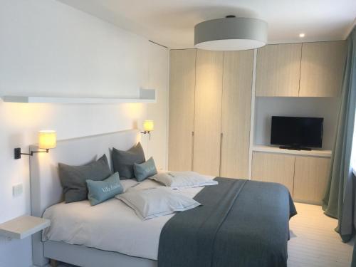 Un ou plusieurs lits dans un hébergement de l'établissement Villa Emilia