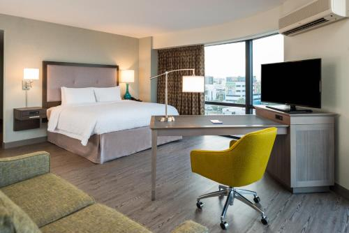 A television and/or entertainment center at Hampton Inn & Suites Miami Wynwood Design District, FL