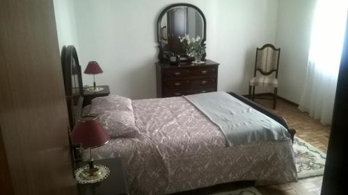 A bed or beds in a room at Casa de Campo São Bernardo