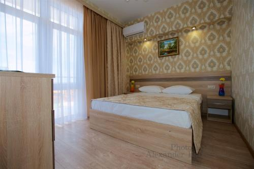 Кровать или кровати в номере Hotel Greek