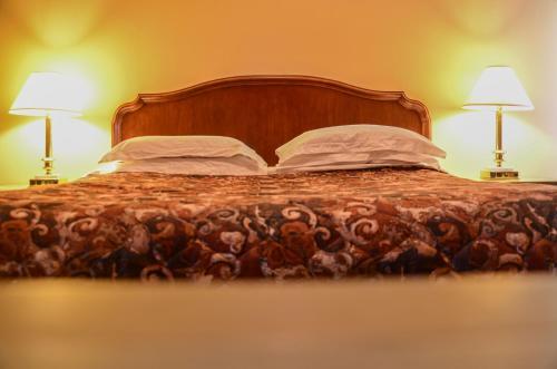 Кровать или кровати в номере Meaford Inn