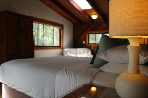 A bed or beds in a room at A Beach House At Byron