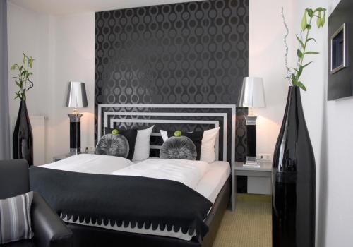 Ein Bett oder Betten in einem Zimmer der Unterkunft Hotel Friends