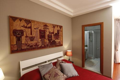 A bed or beds in a room at Residenza D'Epoca B&B Celeste