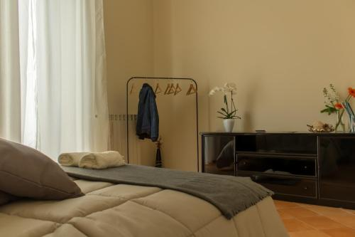 A bed or beds in a room at Fronte al Porto