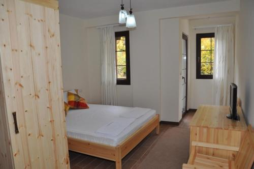 A bed or beds in a room at Hotel Marub