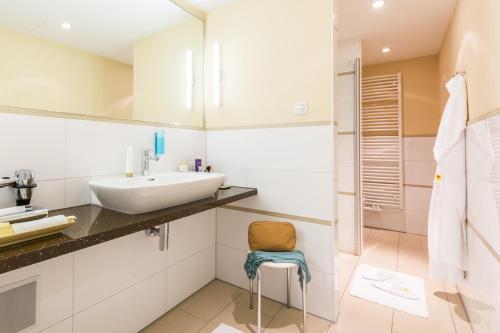 Ein Badezimmer in der Unterkunft Park-Hotel Hübner