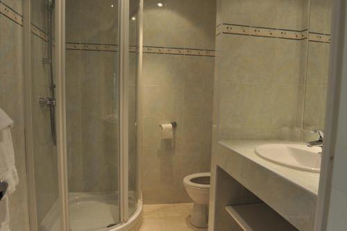 Koupelna v ubytování Hôtel Le Mozart