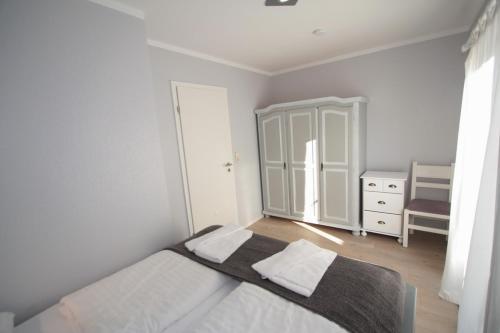 Ein Bett oder Betten in einem Zimmer der Unterkunft Ferienanlage Forellenhof