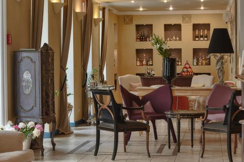 A restaurant or other place to eat at Vozdvyzhensky Boutique Hotel