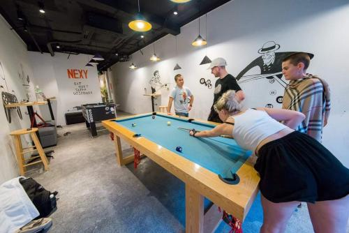 A pool table at Nexy Hostel