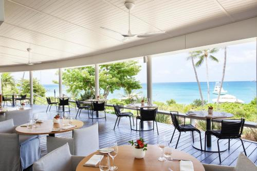 A restaurant or other place to eat at Lizard Island Resort