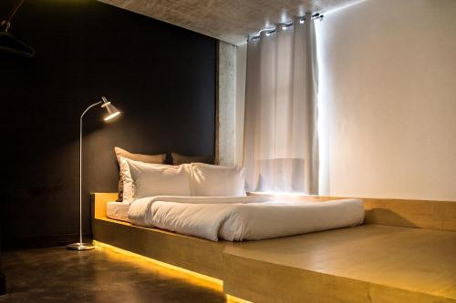 A bed or beds in a room at Urban Boutique Hotel
