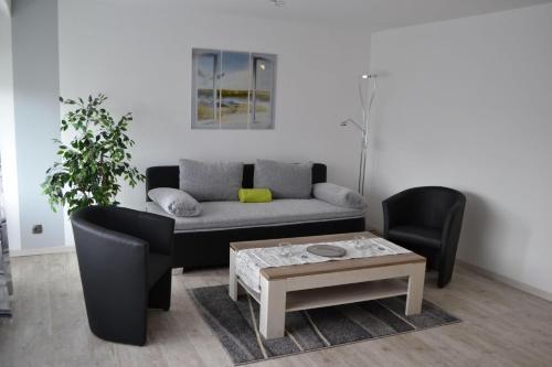 Ein Sitzbereich in der Unterkunft App. Dünenblick, Haus Loreley
