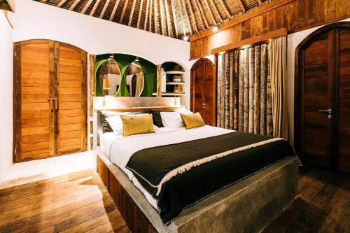 Un ou plusieurs lits dans un hébergement de l'établissement Majo Private Villas