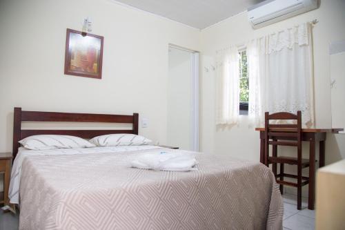 Cama ou camas em um quarto em Hotel Turiassú