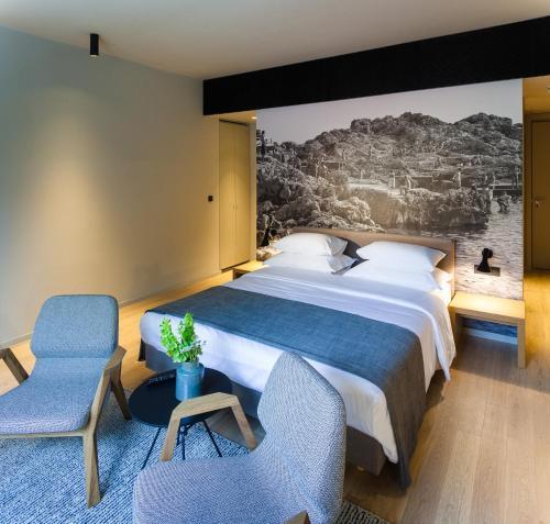 Un ou plusieurs lits dans un hébergement de l'établissement One Suite Hotel