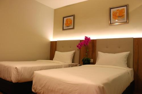 A bed or beds in a room at BIG M Hotel