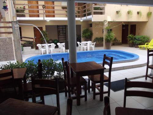 The swimming pool at or near Pousada Alagoana
