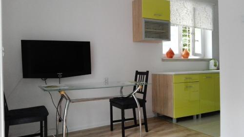 Telewizja i/lub zestaw kina domowego w obiekcie Apartament Dana