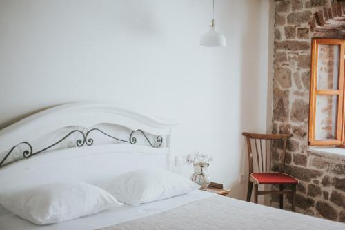 A bed or beds in a room at Casa Milina
