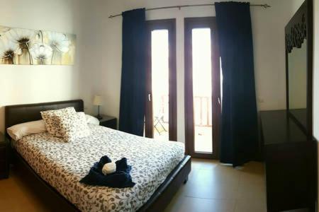 Cama o camas de una habitación en Comfy duplex in Puerto Calero