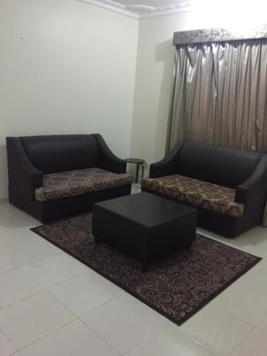 Uma área de estar em Rahati ApartHotel