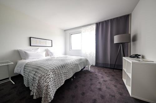 Een bed of bedden in een kamer bij FourSide Trier