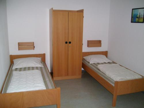 A bed or beds in a room at Jugendherberge Karlsruhe