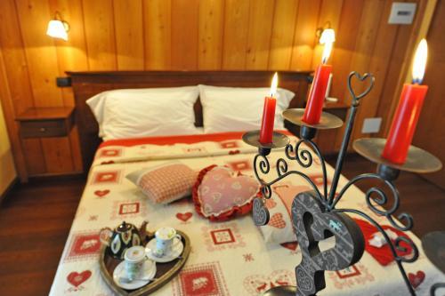Letto o letti in una camera di L'Ancien Paquier Chambre D'Hotes