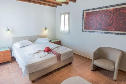 A bed or beds in a room at Naxos Magic Village