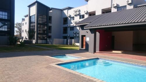 The swimming pool at or near Lifestyle@Village