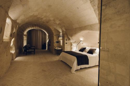 A bed or beds in a room at Palazzotto Residence&Winery