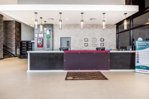 The lobby or reception area at Comfort Inn & Suites near Stadium