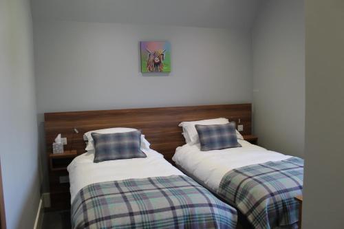 Ein Bett oder Betten in einem Zimmer der Unterkunft Northern Sands Hotel