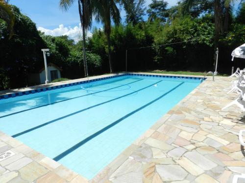 The swimming pool at or close to Pousada Ypê Amarelo