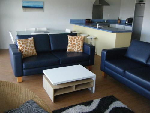 A seating area at Marine Reserved Apartments