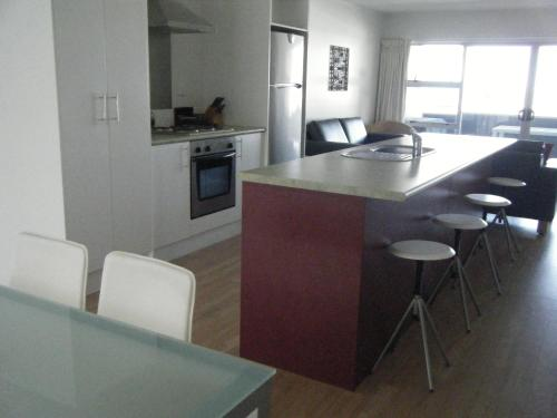 A kitchen or kitchenette at Marine Reserved Apartments